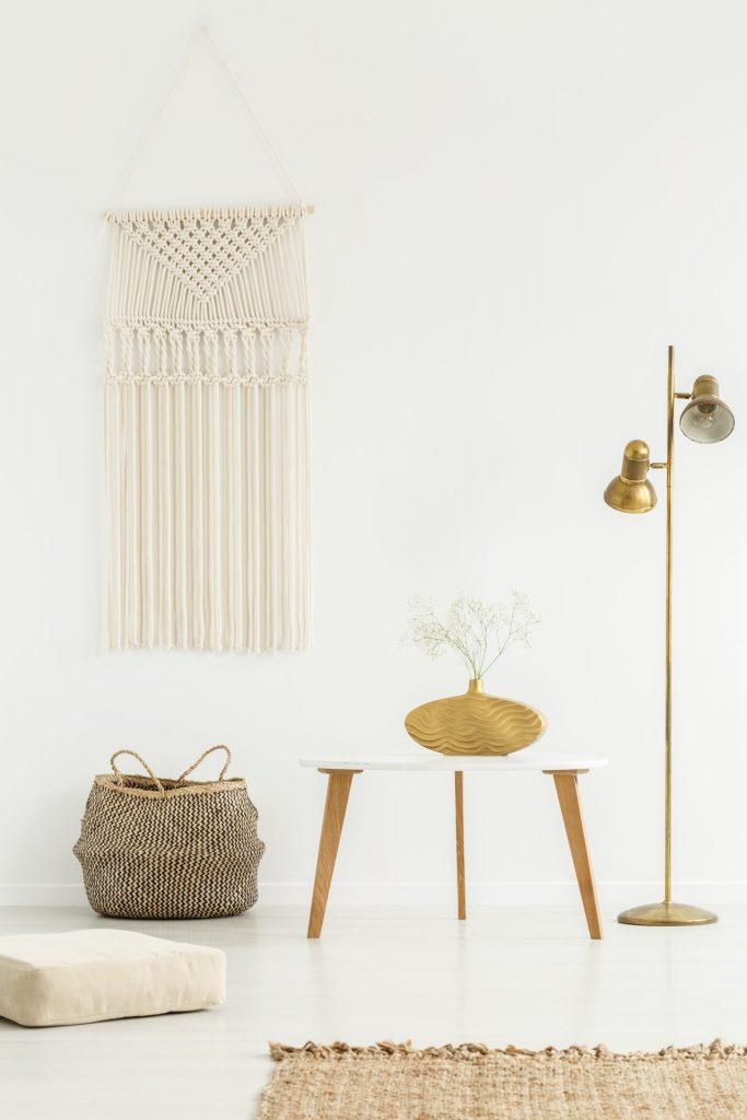 Beige DIY macrame in a boho living room interior